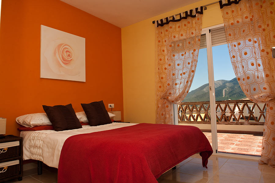 relax and unwind in the tranquil orange bedroom
